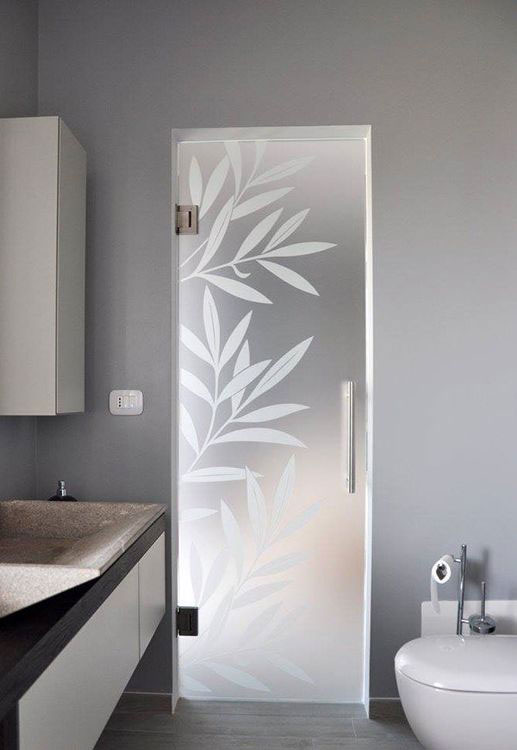frameless glass door with satin glass and sandlblasted leaf design