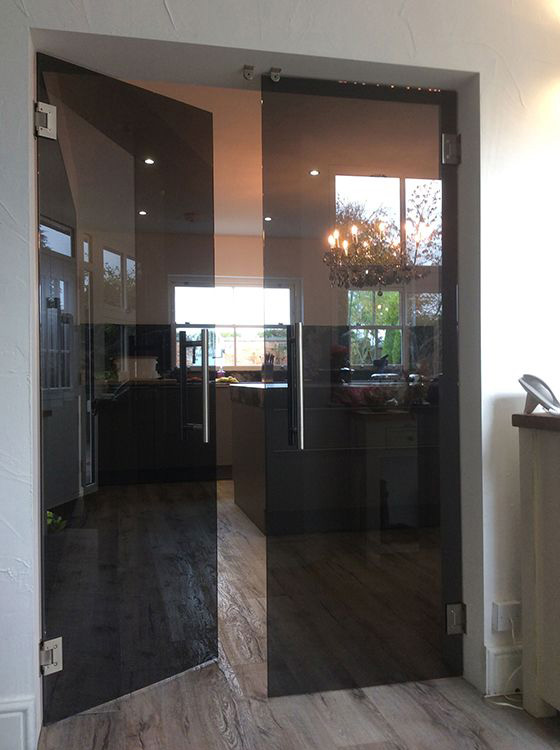 frameless glass double doors with grey tinted glass