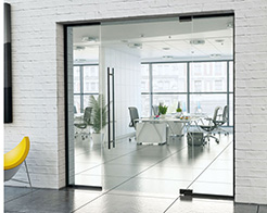 frameless glass partition with hinged door and black hardware