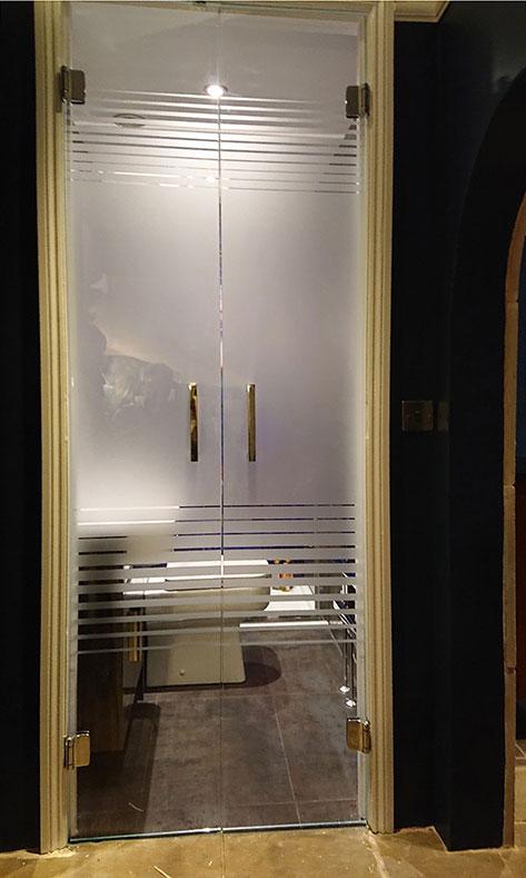 frameless glass doors in timber frame