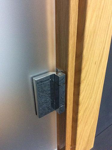 glass door hinge fits into standard frame rebate