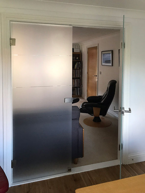 sandblasted frameless glass doors fitted into door lining