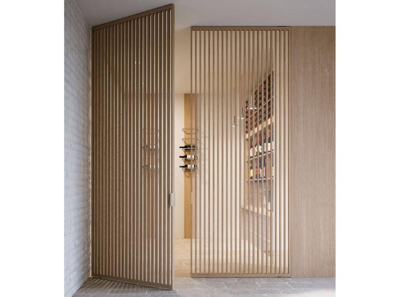 img 10 Piazza Grafic pivot doors - vertical bars - oak finish