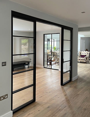 img 5 Piazza Grafic Crittall style sliding doors and panels with visible track