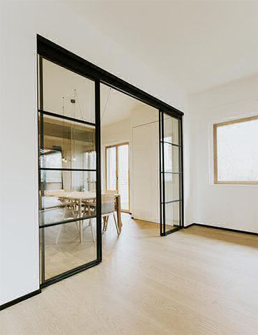 Grafic Crittall style sliding doors and panels - visible track door img 5