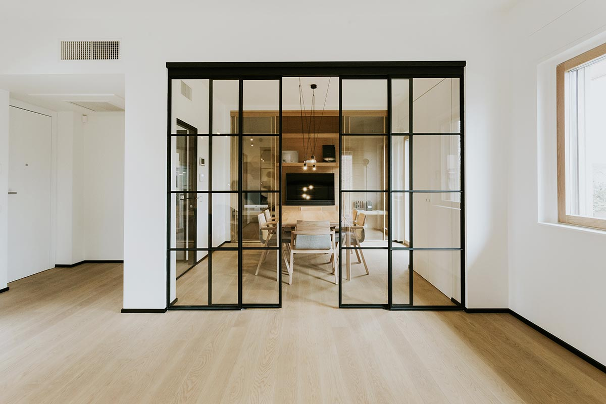 Piazza Crittall style glass partition with sliding doors and panels