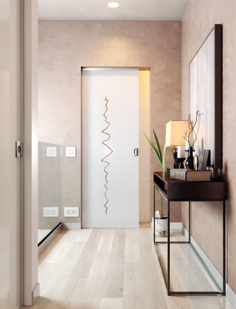 frameless glass pocket door with sandblasted design