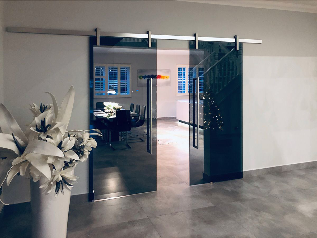 sliding frameless glass double doors - grey tinted