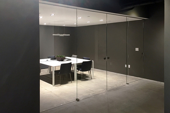 glass partitions with sliding glass doors and panels