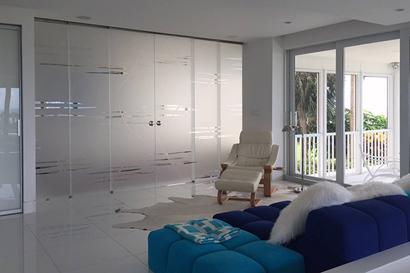 Glass partition with telescopic sliding glass doors