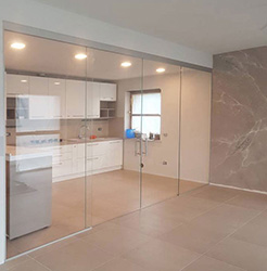 clear glass sliding doors over fixed panels
