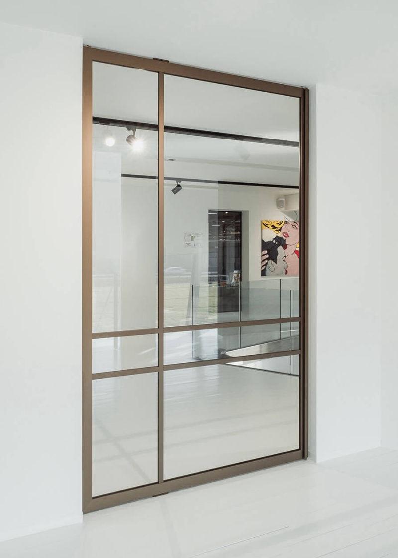 img 16 Piazza Tecno Crittall style pivot door - bronze finish